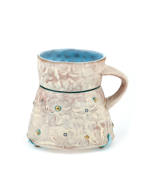 White-washed hourglass mug with gold dots and blue glazed interior handmade by Didem Mert