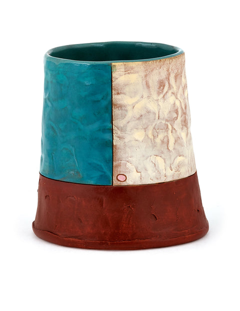 Tall white washed red stoneware cup with turquoise glazed square