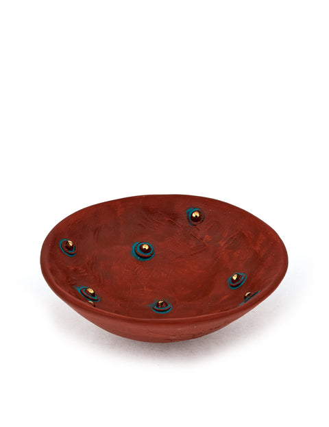 Small red stoneware dish with gold lustre dots handmade by Didem Mert