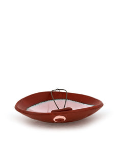 Shallow red stoneware dish with pink glaze and small spoon handmade by Didem Mert