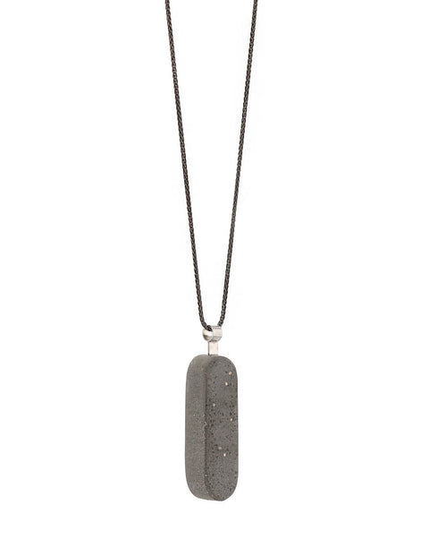 Industrial pendant in concrete and sterling silver on oxidized wheat chain, handmade by Mike Ruta.