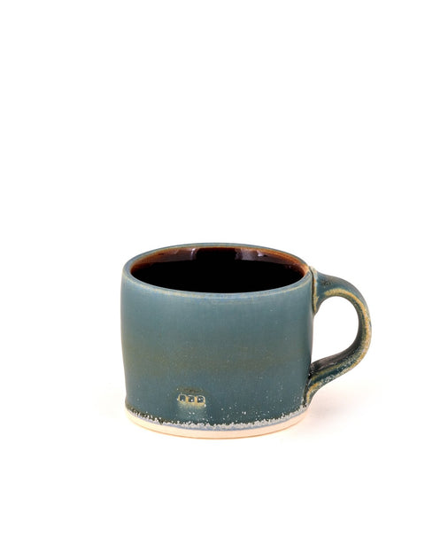 Handmade blue-glazed porcelain mug/cup by Nick DeVries