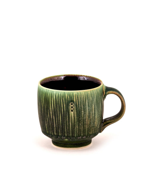 Handmade green-glazed porcelain mug/cup by Nick DeVries