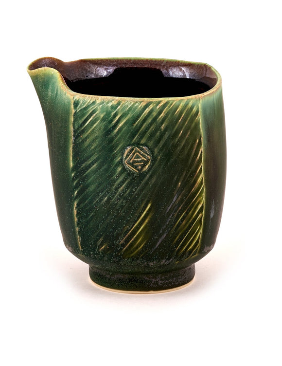 Handmade green-glazed porcelain creamer by Nick DeVries