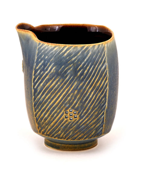 Handmade blue-glazed porcelain creamer by Nick DeVries