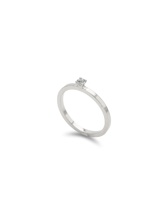 Delicate sterling silver aquamarine solitaire ring handmade by Maura Lenahan.