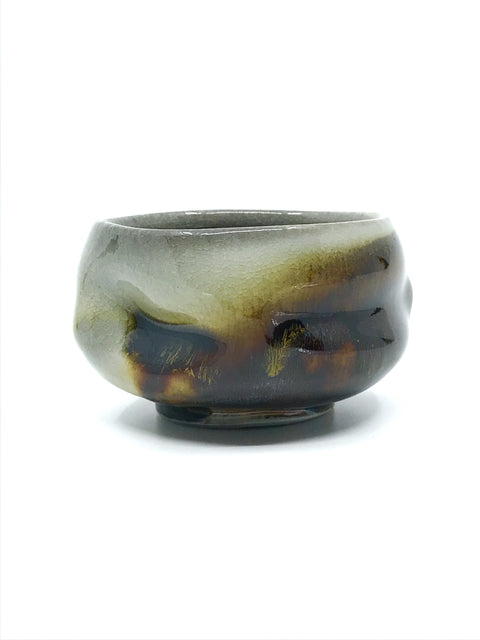 Handmade wood-fired glazed whiskey cup by Chris Gustin