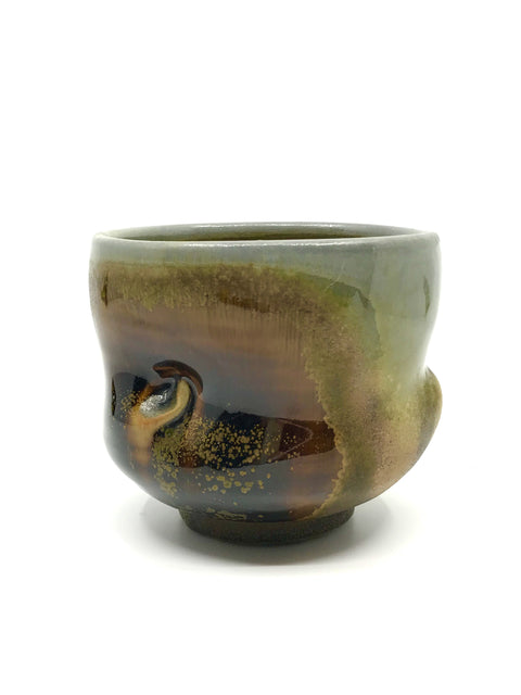 Handmade wood-fired glazed tea bowl by Chris Gustin