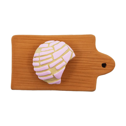 Small Pan Dulce on Cutting Board