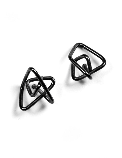 Geometric knot earrings in oxidized sterling silver handmade by Aimee Petkus.