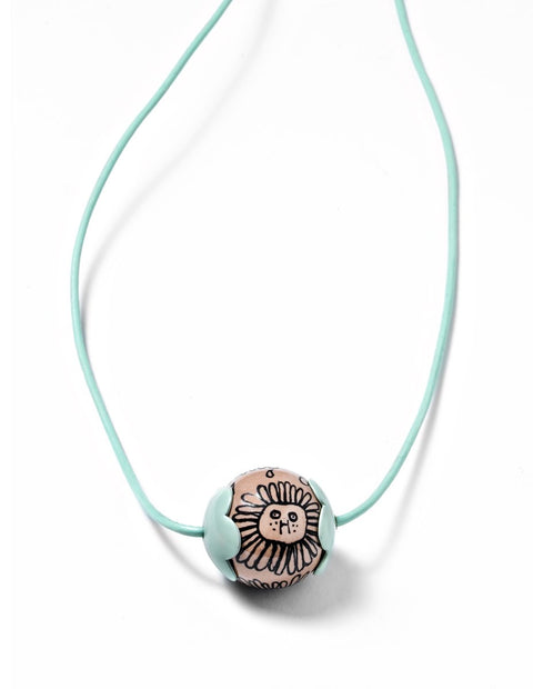 Mint green enameled bead pendant necklace with cowboy illustration handmade by AurŽlie Guillaume.