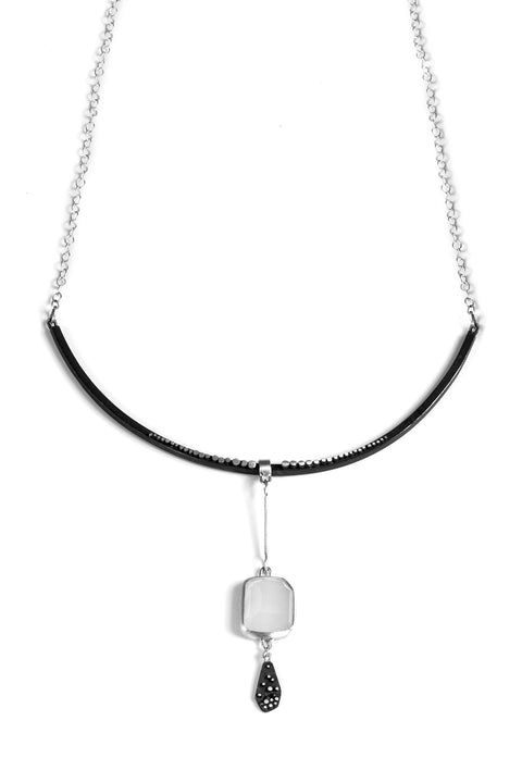 Collar necklace with moonstone pendant and oxidized silver tassle handmade by Ella Calas.
