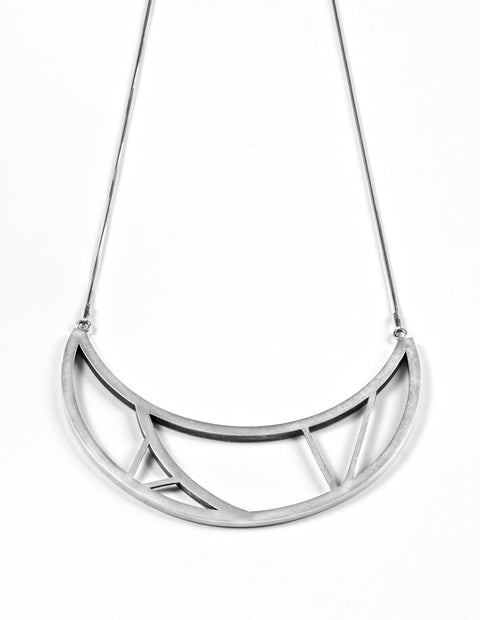 Sterling silver geometric bib necklace handmade by Emily Shaffer.