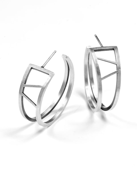 Sterling silver triangular hoop earrings handmade by Emily Shaffer.