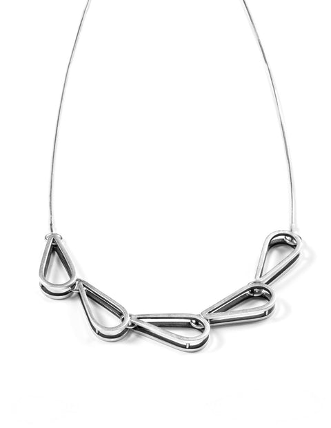Sterling silver teardrop bib necklace handmade by Emily Shaffer.