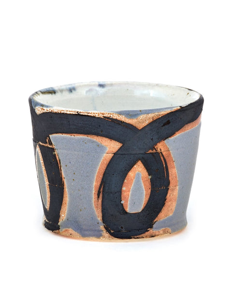 Small wheel thrown cup with wax resisted glaze patterns and designs handmade by HP Bloomer.