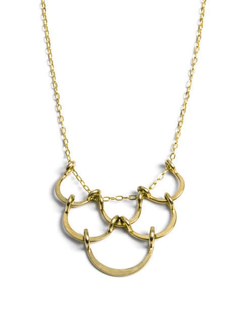 Delicate gold fill looped clods bib necklace handmade by Lisa Slodki.