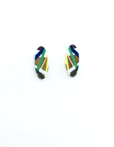 Colorful and unique wood and dyed polyurethane stud earrings, handmade by Laura Jaklitsch.