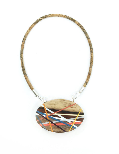 Colorful and unique wood and dyed polyurethane statement necklace, handmade by Laura Jaklitsch.