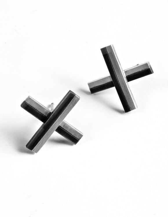 Small sterling silver and steel stud earrings, handmade by Lindsey Snell.