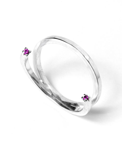 Delicate sterling silver stack ring with ruby gemstones handmade by Maura Lenahan.