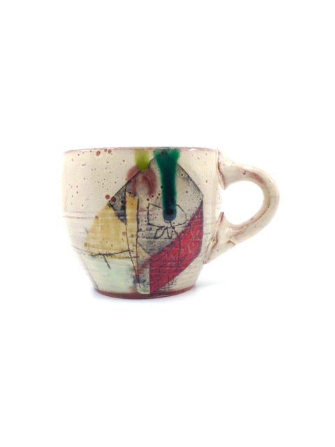 Handled cup in earthenware with painted underglaze, handmade by Michael Connelly.