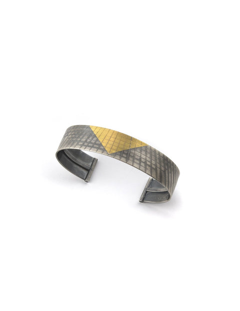 Sterling silver cuff bracelet with 24k gold triangle detailing handmade by 2017 Lillstreet Art Center resident artist Peter Antor.