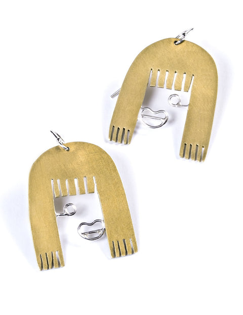 Portrait of face with a bangs earrings in brass and sterling silver handmade by artist Stephanie O'Brien.
