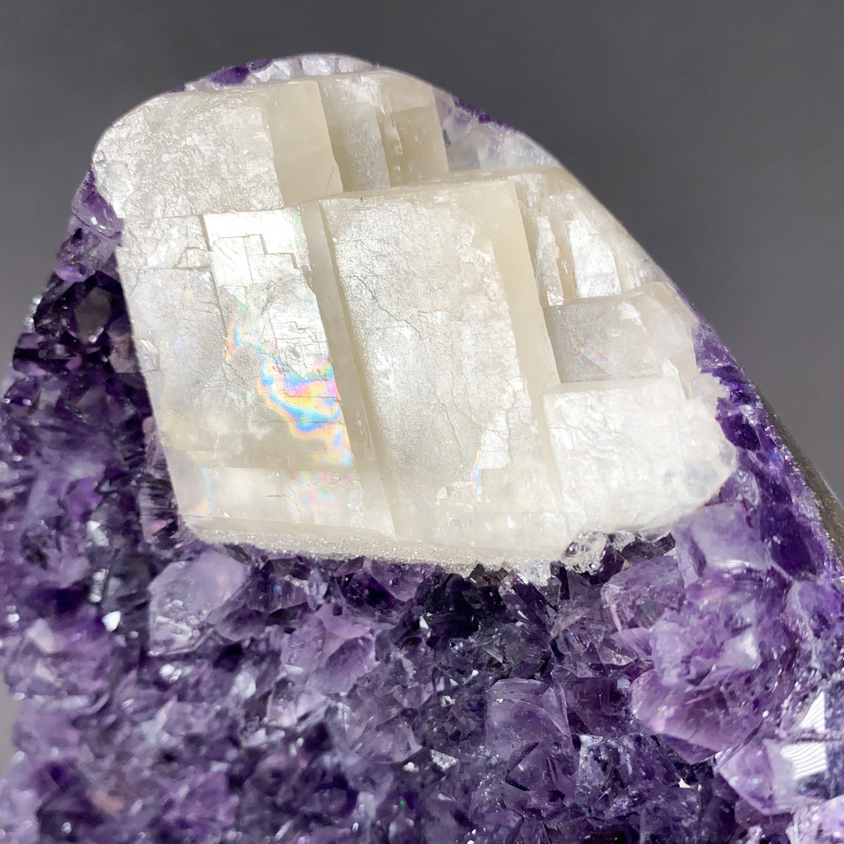 Large White Calcite Rhombohedron with Rainbow inclusions