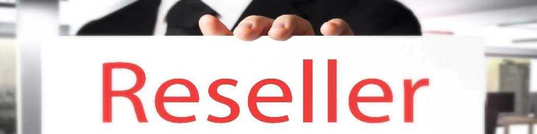 Hand holding reseller sign