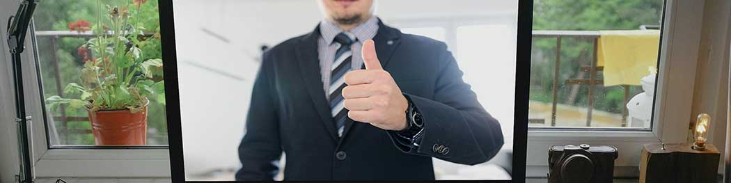 Man in suit with thumb up