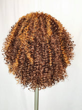 Brown with light highlights, curly
