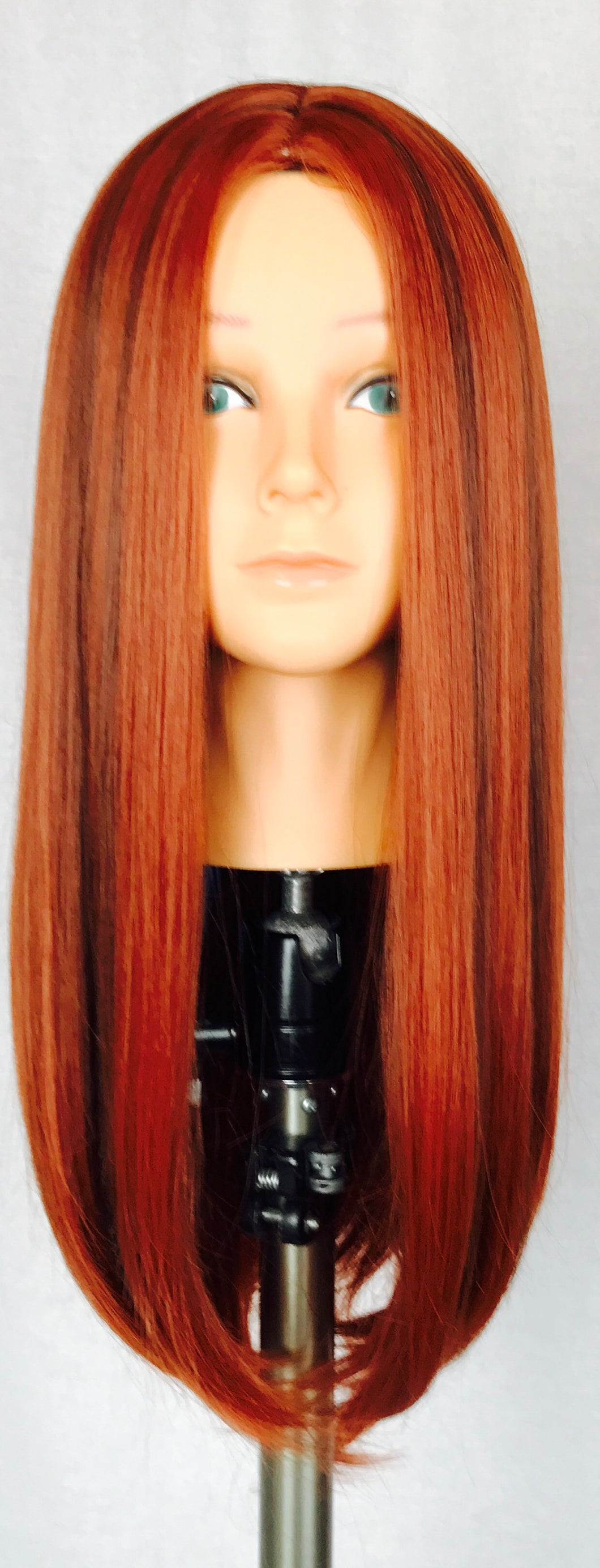 Straight auburn with brown streak, center part