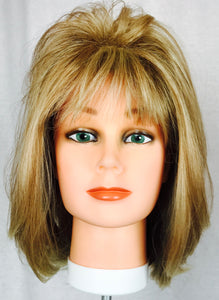 Feathered blonde longer bob, bangs
