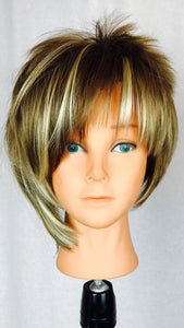 Asymmetrical, short brown with blonde highlights