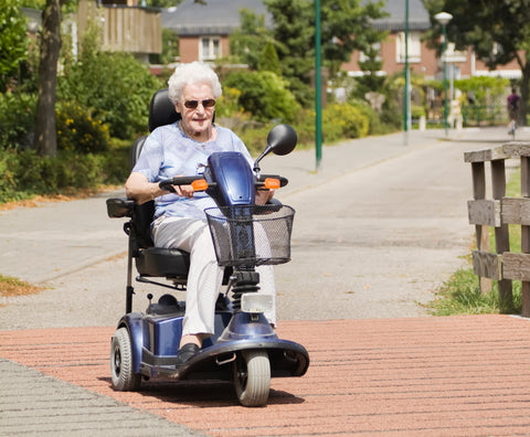 A senior enjoying strolling around with her mobility scooter.
