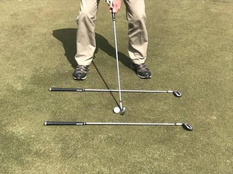 Use alignment rods to help correct a golf slice