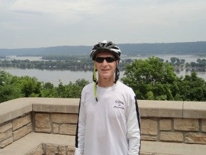 One tired rider with Mississippi River in background.