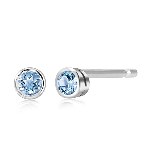 Blue Topaz Bezel Set Stud Earrings Weighing 0.25 Carat - Chillatto