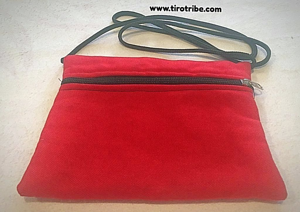 Red canvas travel bag with strap