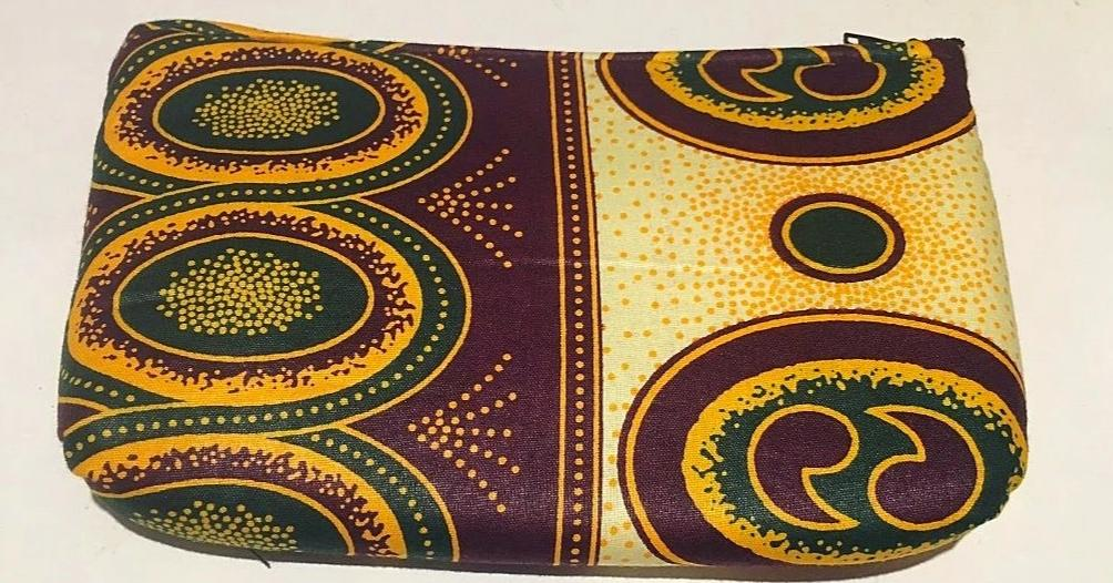 Traitional Kitenge cream essential oil purse (8 pockets)