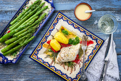 baked halibut and herbs with asparagus and lemon
