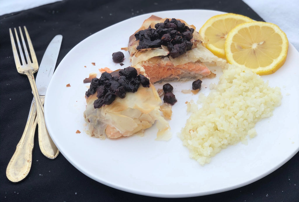 Steelhead trout fillet wrapped in phyllo with saskatoon savory sauce