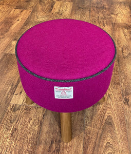 Fuchsia Harris Tweed Footstool with Charcoal Piping and Rustic Wooden Legs.