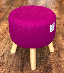 Fuchsia Harris Tweed Upholstered Footstool with Light Rustic Wooden Legs.