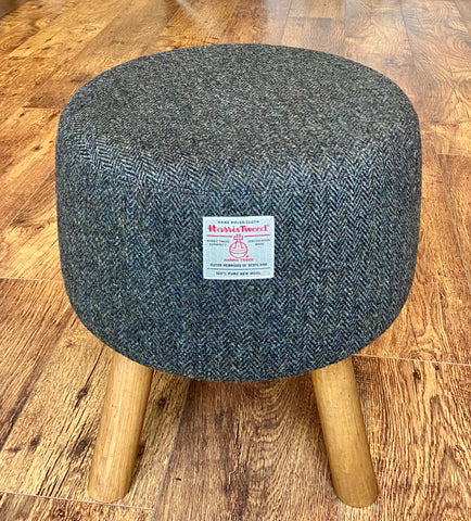 Charcoal Harris Tweed Upholstered Footstool with Rustic Wooden Legs.