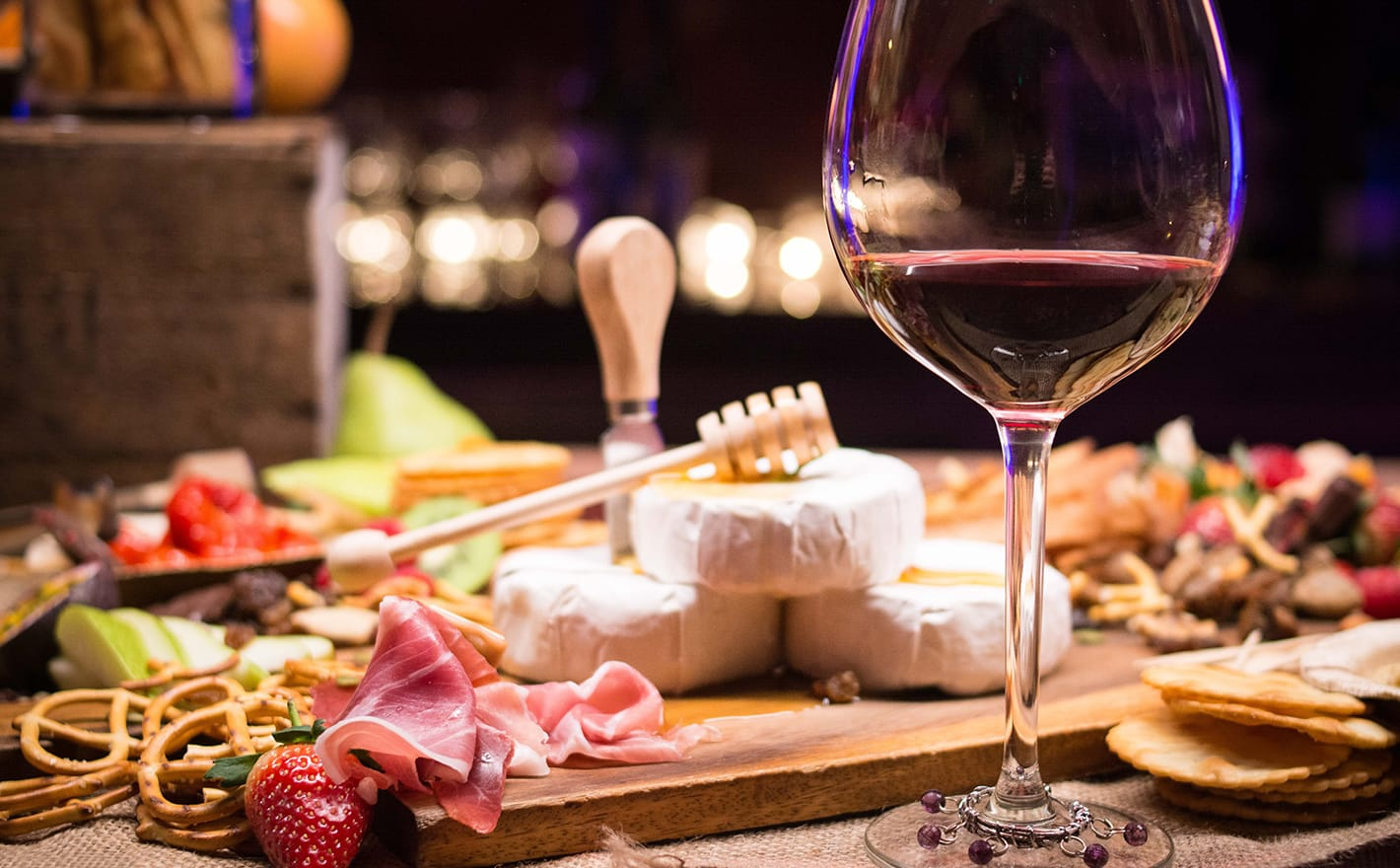 Charcuterie board and glass of red wine in Rome, Italy