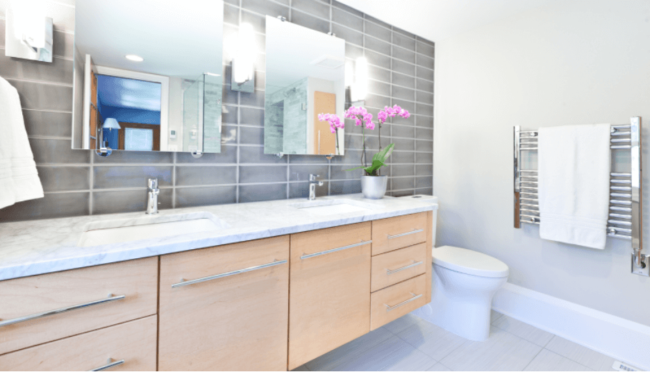Simply Exotic Master Bathroom with an accent wall. These light tones match the soothing soft grey walls perfectly, creating a relaxing atmosphere, inviting the owner to unwind.