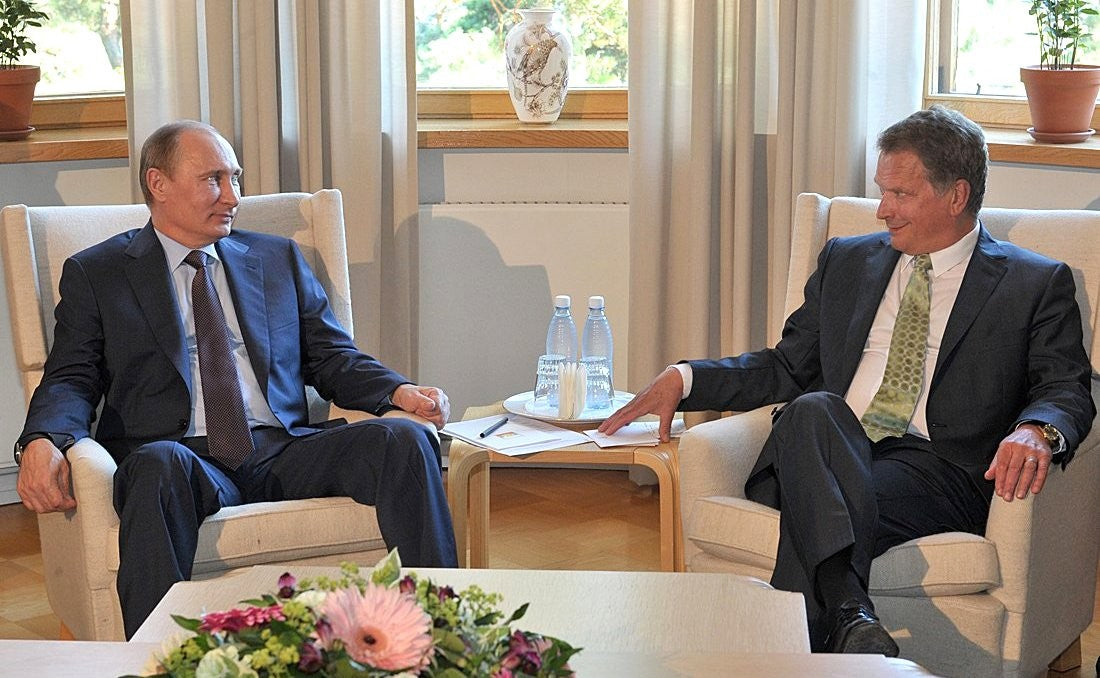 Sauli Niinistö cracks a smile in a previous meeting with Putin