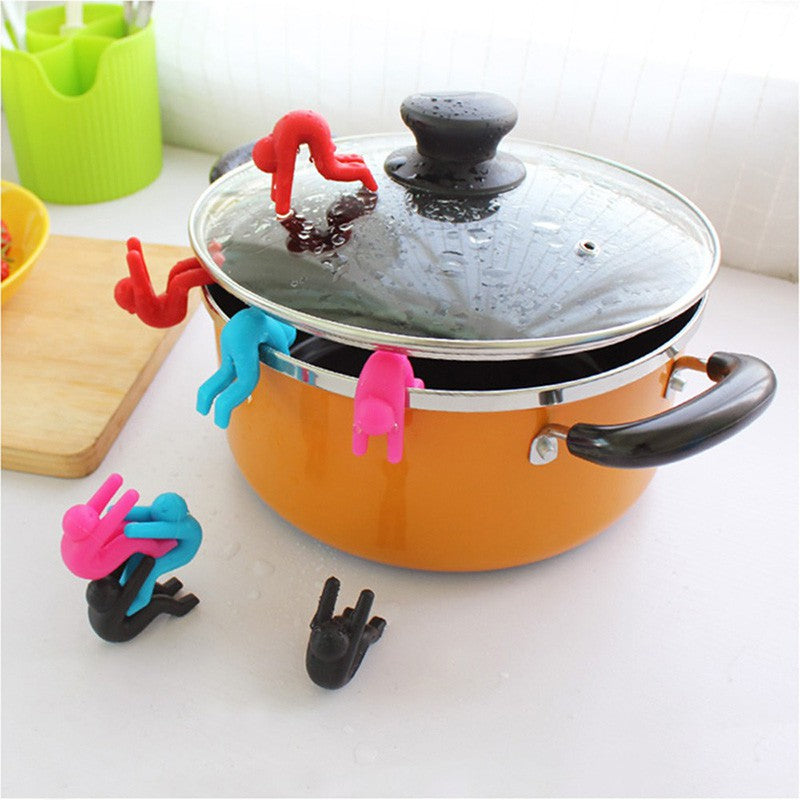 Red, blue, pink or black Silicon stoppers making cooking fun and stopping pots boiling over